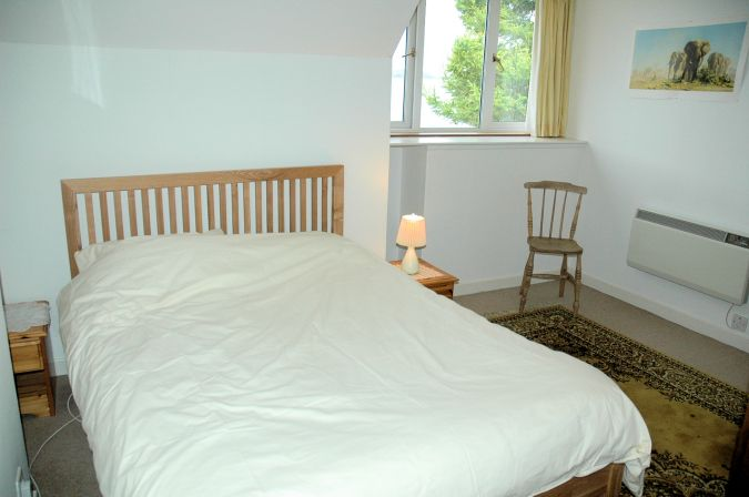 The family bedroom in Ceol na Mara at Shieldaig has a double bed plus some full-size bunk beds.