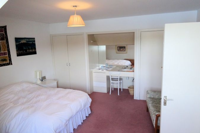 The upstairs double bedroom in Ceol na Mara at Shieldaig is very spacious and has excellent sea views.